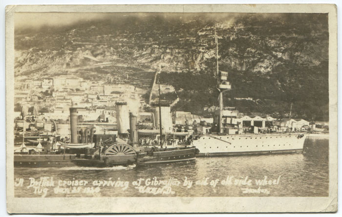 ANON A British cruiser arriving at Gibraltar by aid of old side wheel tug, Jan 27 1920