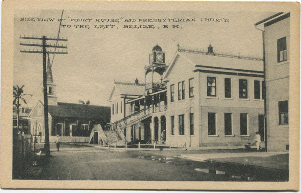 PHOTO & ART POSTAL CARD CO. Side View of Court House and Presbyterian Church to the left, Belize, B.H.