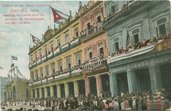 DIAMOND NEWS CO Visitors at the Hotel Inglaterra (Havana, Cuba) watching the crowd from the balconies on Independence day May the 20th.