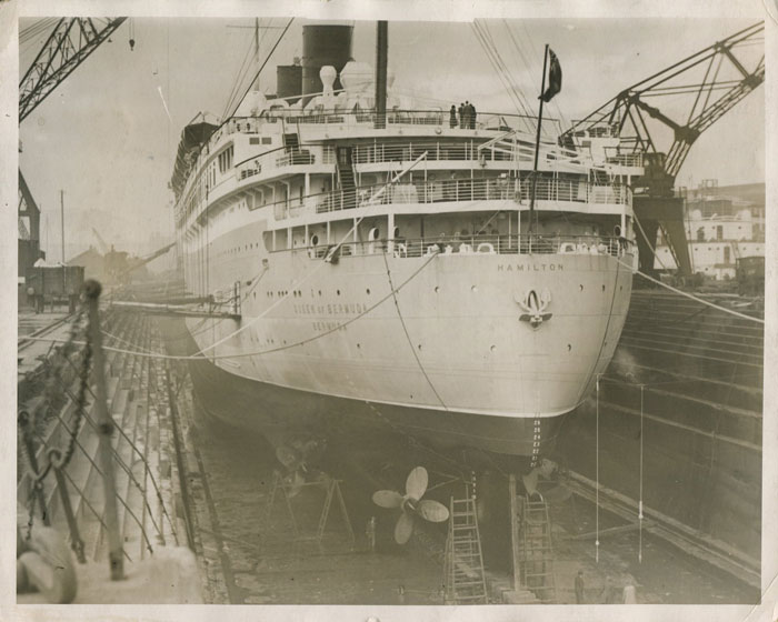 FOX PHOTOS S.S. Queen of Bermuda in dry dock at Barrow in Furness